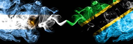 Argentina vs Tanzania, Tanzanian smoky mystic fire flags placed side by side. Thick colored silky abstract smoke flags concept