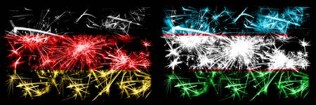 Germany, German vs Uzbekistan, Uzbek New Year celebration travel sparkling fireworks flags concept background. Combination of two abstract states flags. 版權商用圖片