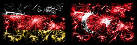 Germany, German vs Turkey, Turkish New Year celebration travel sparkling fireworks flags concept background. Combination of two abstract states flags.