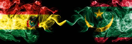 Bolivia, Bolivian vs Mauritania, Mauritanian smoky mystic states flags placed side by side. Concept and idea thick colored silky abstract smoke flags
