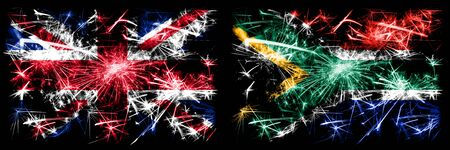 Great Britain, United Kingdom vs South Africa, African New Year celebration travel sparkling fireworks flags concept background. Combination of two abstract states flags.