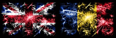 Great Britain, United Kingdom vs Romania, Romanian New Year celebration travel sparkling fireworks flags concept background. Combination of two abstract states flags. 스톡 콘텐츠