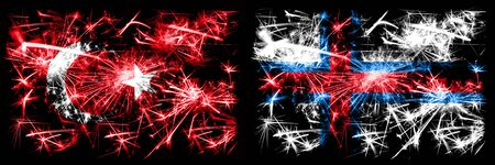 Turkey, Turkish vs Faroe Islands New Year celebration sparkling fireworks flags concept background. Combination of two abstract states flags. Stock Photo