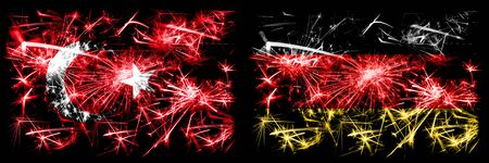 Turkey, Turkish vs Germany, German New Year celebration sparkling fireworks flags concept background. Combination of two abstract states flags. Stock Photo