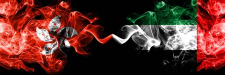Hong Kong, China vs United Arab Emirates, Emirati smoky mystic states flags placed side by side. Concept and idea thick colored silky abstract smoke flags