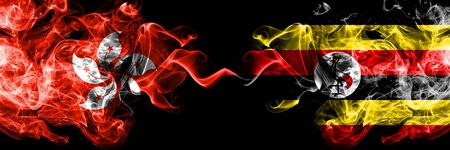 Hong Kong, China vs Uganda, Ugandan smoky mystic states flags placed side by side. Concept and idea thick colored silky abstract smoke flags