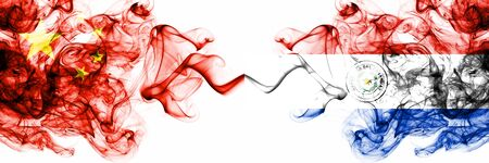 China, Chinese vs Paraguay, Paraguayan smoky mystic states flags placed side by side. Concept and idea thick colored silky abstract smoke flags