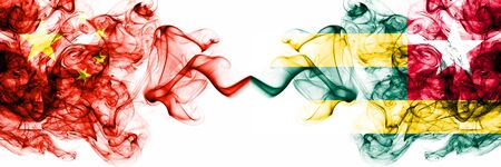 China, Chinese vs Togo, Togolese smoky mystic states flags placed side by side. Concept and idea thick colored silky abstract smoke flags