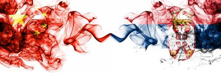 China, Chinese vs Serbia, Serbian smoky mystic states flags placed side by side. Concept and idea thick colored silky abstract smoke flags