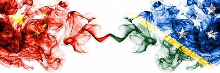 China, Chinese vs Solomon Islands smoky mystic states flags placed side by side. Concept and idea thick colored silky abstract smoke flags