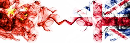 China, Chinese vs United Kingdom, British smoky mystic states flags placed side by side. Concept and idea thick colored silky abstract smoke flags