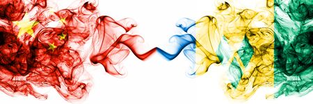 China, Chinese vs Saint Vincent and the Grenadines smoky mystic states flags placed side by side. Concept and idea thick colored silky abstract smoke flags Banco de Imagens