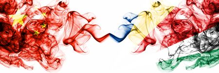 China, Chinese vs Seychelles, Seychelloise smoky mystic states flags placed side by side. Concept and idea thick colored silky abstract smoke flags