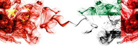 China, Chinese vs United Arab Emirates, Emirati smoky mystic states flags placed side by side. Concept and idea thick colored silky abstract smoke flags Banco de Imagens