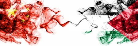 China, Chinese vs Palestine, Palestinian smoky mystic states flags placed side by side. Concept and idea thick colored silky abstract smoke flags