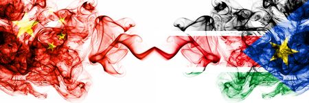 China, Chinese vs South Sudan smoky mystic states flags placed side by side. Concept and idea thick colored silky abstract smoke flags