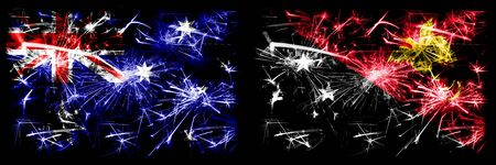 Australia, Ozzie vs Papua New Guinea New Year celebration sparkling fireworks flags concept background. Combination of two abstract states flags.