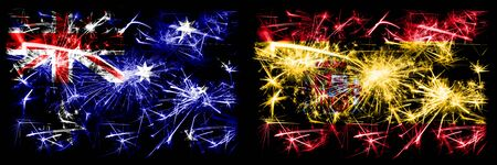 Australia, Ozzie vs Spain, Spanish New Year celebration sparkling fireworks flags concept background. Combination of two abstract states flags.