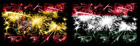 Spanish vs Hungary, Hungarian New Year celebration sparkling fireworks flags concept background. Combination of two abstract states flags.