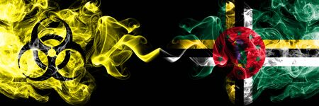 Quarantine in Dominica. Coronavirus COVID-19 lockdown. Smoky mystic flag of Dominica with biohazard symbol placed side by side. Stock fotó