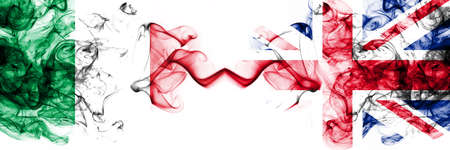 Italy vs United Kingdom, British smoky mystic flags placed side by side. Thick colored silky abstract smoke flags