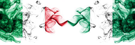 Italy vs Nigeria, Nigerian smoky mystic flags placed side by side. Thick colored silky abstract smoke flags