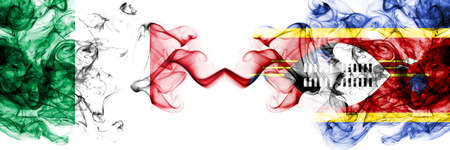 Italy vs Swaziland, Swazi smoky mystic flags placed side by side. Thick colored silky abstract smoke flags 版權商用圖片
