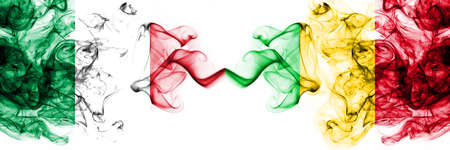 Italy vs Mali smoky mystic flags placed side by side. Thick colored silky abstract smoke flags 版權商用圖片