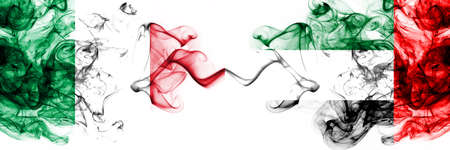Italy vs United Arab Emirates, Emirati smoky mystic flags placed side by side. Thick colored silky abstract smoke flags