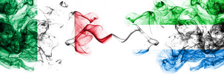 Italy vs Sierra Leone smoky mystic flags placed side by side. Thick colored silky abstract smoke flags 版權商用圖片