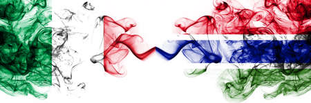 Italy vs Gambia, Gambian smoky mystic flags placed side by side. Thick colored silky abstract smoke flags