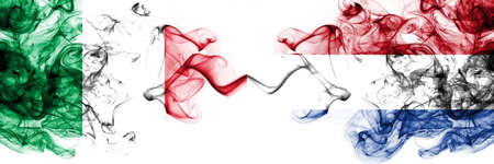 Italy vs Netherlands, Dutch smoky mystic flags placed side by side. Thick colored silky abstract smoke flags 版權商用圖片