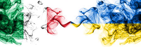 Italy vs Ukraine, Ukrainian smoky mystic flags placed side by side. Thick colored silky abstract smoke flags