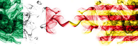 Italy vs Spain, Catalonia, Catalan, Senyera smoky mystic flags placed side by side. Thick colored silky abstract smoke flags