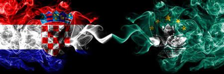 Croatia, Croatian vs Macau, China, Chinese smoky mystic flags placed side by side. Thick colored silky abstract smoke flags.