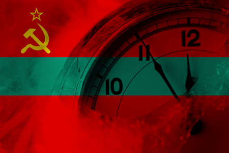 Transnistria flag with clock close to midnight in the background. Happy New Year concept