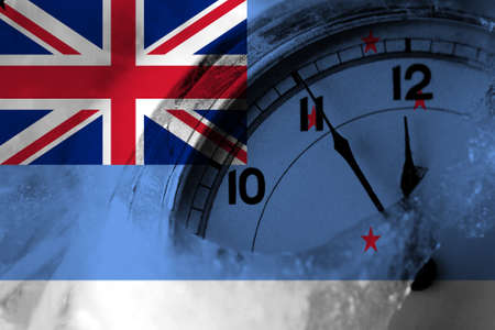 New Zealand, Ross Dependency flag with clock close to midnight in the background. Happy New Year concept