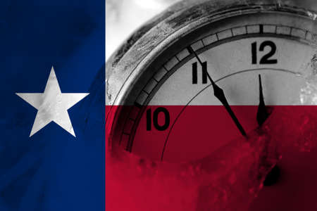 United States of America, America, US, USA, American, Texas flag with clock close to midnight in the background. Happy New Year concept