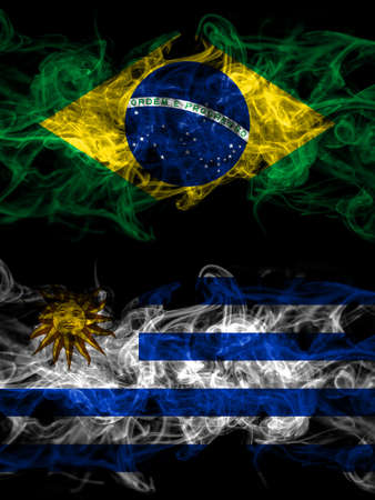 Brazil, Brazilian vs Uruguay, Uruguayan smoky mystic flags placed side by side. Thick colored silky abstract smoke flags. 免版税图像