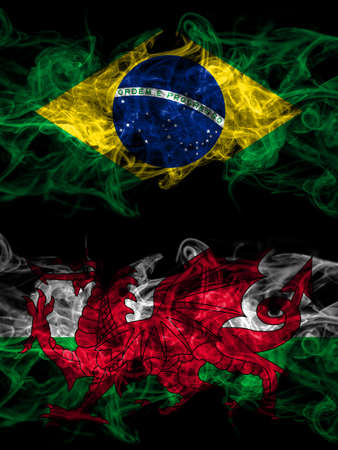 Brazil, Brazilian vs Wales, United Kingdom smoky mystic flags placed side by side. Thick colored silky abstract smoke flags. 免版税图像