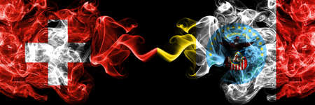 Switzerland, Swiss vs United States of America, America, US, USA, American, Columbus, Ohio smoky mystic flags placed side by side. Thick colored silky abstract smoke flags. Stock Photo