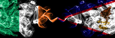 Republic of Ireland, Irish vs United States of America, America, US, USA, American, American Samoa smoky mystic flags placed side by side. Thick colored silky abstract smoke flags.