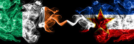 Republic of Ireland, Irish vs Yugoslavia, Yugoslavian smoky mystic flags placed side by side. Thick colored silky abstract smoke flags.