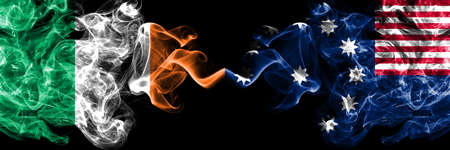 Republic of Ireland, Irish vs United States of America, America, US, USA, American, Easton, Pennsylvania smoky mystic flags placed side by side. Thick colored silky abstract smoke flags. Stock fotó - 162759017