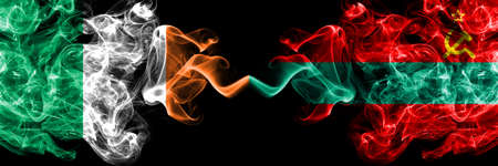 Republic of Ireland, Irish vs Transnistria smoky mystic flags placed side by side. Thick colored silky abstract smoke flags.