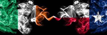 Republic of Ireland, Irish vs United States of America, America, US, USA, American, Texas smoky mystic flags placed side by side. Thick colored silky abstract smoke flags. Stock fotó