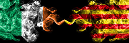 Republic of Ireland, Irish vs Spain, Spanish, Catalonia, Senyera smoky mystic flags placed side by side. Thick colored silky abstract smoke flags.