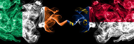 Republic of Ireland, Irish vs United States of America, America, US, USA, American, North Carolina smoky mystic flags placed side by side. Thick colored silky abstract smoke flags.