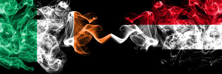 Republic of Ireland, Irish vs Yemen, Yemeni smoky mystic flags placed side by side. Thick colored silky abstract smoke flags.