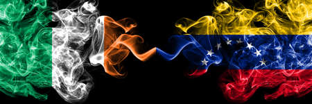 Republic of Ireland, Irish vs Venezuela smoky mystic flags placed side by side. Thick colored silky abstract smoke flags. Stock fotó
